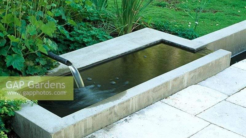 Gap Gardens Water Feature Falls Into Cement